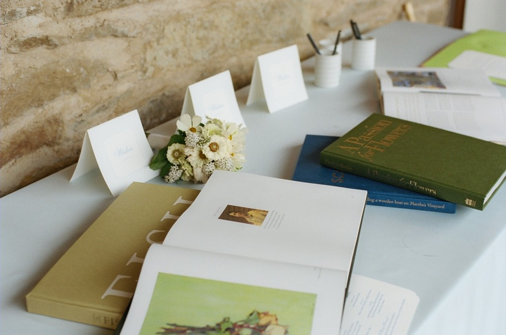 guest sign in books at wedding